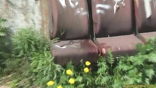 Nasty brunette chick pisses on the chair left outdoors--_short_preview.mp4