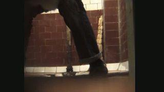 A hidden voyeur camera films stranger white girl pissing in the toilet room--_short_preview.mp4