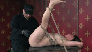 Brunette white lady bound and stretched on the wooden box--_short_preview.mp4