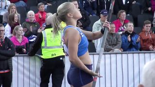 Hot blonde pole vaulter competes at a packed stadium--_short_preview.mp4
