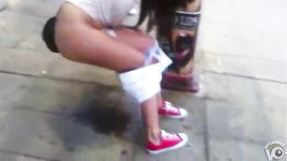 Drunken coed girl urinates on a busy sidewalk--_short_preview.mp4