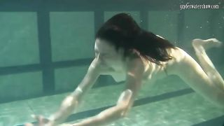 Adorable brunette Russian teen underwater in her dress--_short_preview.mp4