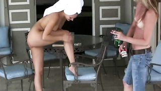 Hot young lady lotions up her body outdoors--_short_preview.mp4