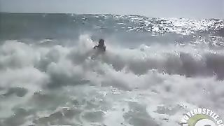 Busty brunette's lower part of a bikini drops as huge waves hit her--_short_preview.mp4