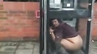 Pissing in the phone booth--_short_preview.mp4
