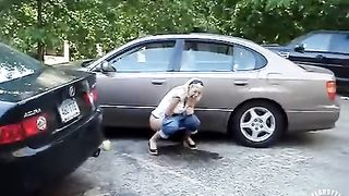 Laughing chick relieves herself in a parking lot--_short_preview.mp4