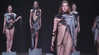 Fashion models drop balloons filled with water on the catwalk--_short_preview.mp4