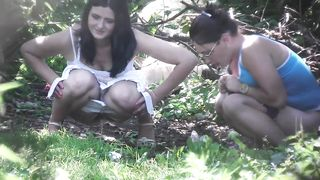 Two scarcely-clothed gals make water in the woods--_short_preview.mp4