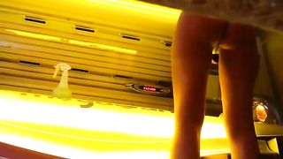 Attractive brass undresses before jumping into a tanning bed--_short_preview.mp4