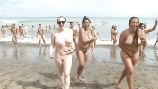 Huge group of nudists swim in the ocean--_short_preview.mp4