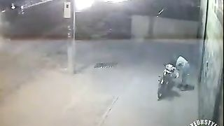Female motorcyclist gets caught on security cam urinating--_short_preview.mp4