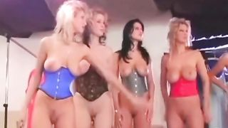 Large-breasted models flash underbust corsets at the naughty fashion show--_short_preview.mp4