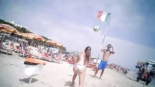 Bikini girl and her man play with a volleyball--_short_preview.mp4