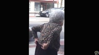 Old lady took a slash on the street chair--_short_preview.mp4