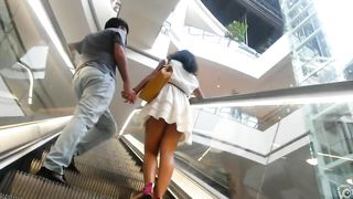 Short pleated skirt uppie on an escalator--_short_preview.mp4
