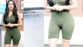 TV host wears a tight outfit in front of a camera--_short_preview.mp4