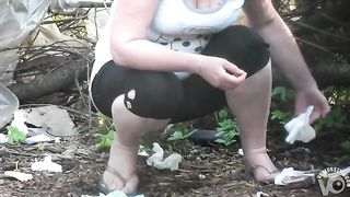 Woman with a big bum in spandex pants urinates in the bushes--_short_preview.mp4