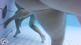 Naked women underwater at a nudist resort pool--_short_preview.mp4