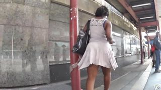 Smoking hot ebony lady with big booty walks around in a short dress--_short_preview.mp4