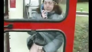 Ginger chick pisses in a phone booth in winter--_short_preview.mp4