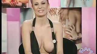 Yummy nipple slip in low cut dress on Spanish TV--_short_preview.mp4