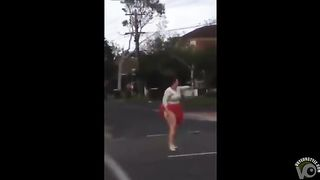 Crazy woman undresses in the middle of the street--_short_preview.mp4