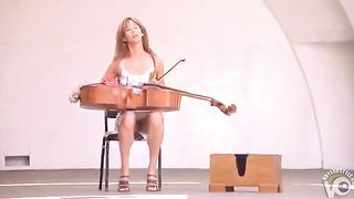 Sexy musician reveals her panties while tuning her instrument--_short_preview.mp4