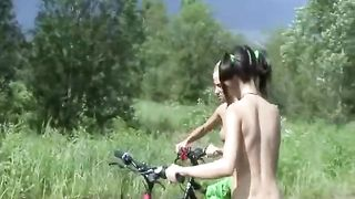 Naked teens ride bikes down a country road--_short_preview.mp4