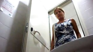 Blonde milf in a blue dress uses public toilet--_short_preview.mp4