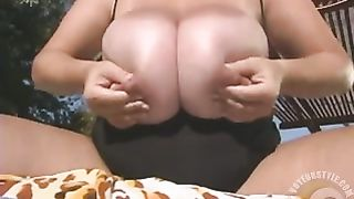 Woman takes her huge natural melons near the pool--_short_preview.mp4