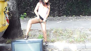 Public pissing pleases a lovely girl in sporty shorts--_short_preview.mp4