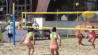 Stunning babes enjoy playing a match of beach volleyball--_short_preview.mp4