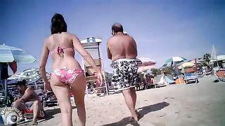 Mature butt in bikini bottoms at the beach--_short_preview.mp4