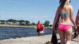 Attractive hottie in a flimsy bikini walks around the beach with her man--_short_preview.mp4