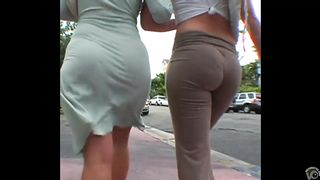 Two girls walk down the street in revealing clothes--_short_preview.mp4