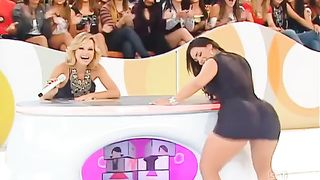 Chubby Latina in a tight dress sings on TV show--_short_preview.mp4