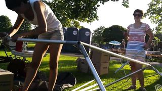 Slim woman unveils her boobs while trying to set up the tent--_short_preview.mp4