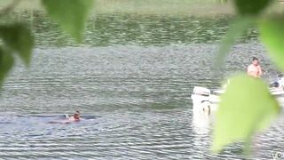 Nudist couple has fun in the middle of a beautiful lake--_short_preview.mp4
