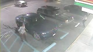 Desperate black woman soaks the parking lot next to the car--_short_preview.mp4