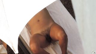 Curvy woman with a hairy labia relaxes under an umbrella--_short_preview.mp4