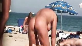 Naked milf takes a piss at the beach--_short_preview.mp4