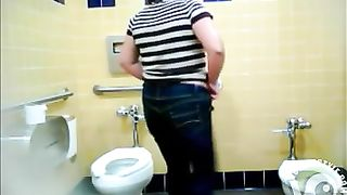 Chubby Mexican woman urinates in a public toilet--_short_preview.mp4