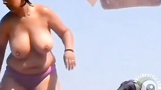 Chubby woman demonstrates her gigantic jugs--_short_preview.mp4