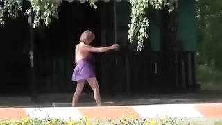 Drunk village chick enjoys doing cartwheels in a short summer dress--_short_preview.mp4