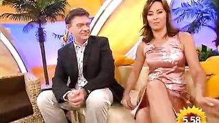 Panty upskirt of TV host in pink satin dress--_short_preview.mp4