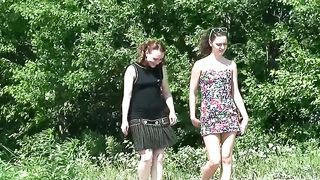 Redhead and brunette Russian young chicks pissing on the road--_short_preview.mp4