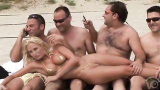 Hot girls in tiny bikinis roam the beach--_short_preview.mp4