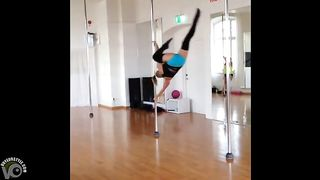Stunningly fit girl swings around the pole--_short_preview.mp4