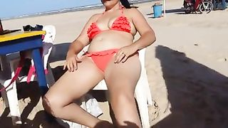 Chubby woman sets up her red bikini at the beach--_short_preview.mp4