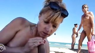 Dick and ball sucking wife at a public beach--_short_preview.mp4